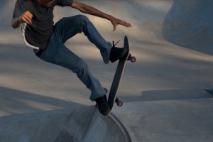368233-skateboarder-jumping-out-of-the-skatboarding-pit